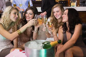 Pretty friends drinking champagne together — Стоковое фото