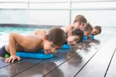 Cute swimming class at the pool — Stock Photo