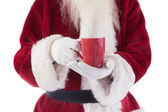 Santa holds a red cup — Stock Photo