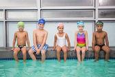 Cute swimming class smiling at camera — Foto de Stock
