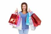 Woman showing shopping bags with the thumbs up — Stock Photo