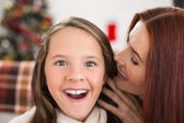 Mother telling her daughter a christmas secret — Stock Photo