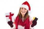 Smiling young brunette with gift and credit card — ストック写真