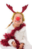 Cute little girl wearing red nose and tinsel — Stock Photo