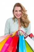 Smiling young woman holding shopping bags — Stock Photo