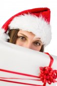 Festive brunette showing a gift — Stock Photo