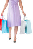 Mid section of woman holding shopping bags — Stock Photo