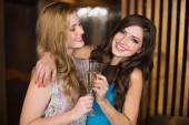 Attractive friends toasting with champagne — Stock Photo