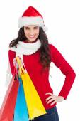 Brunette in winter clothes holding shopping bags — Photo