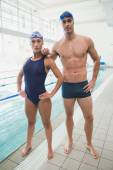 Male and female swimmers by pool — Foto Stock