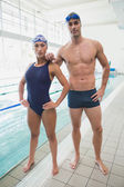 Male and female swimmers by pool — Photo