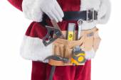 Father Christmas is wearing a tool belt — Stock Photo