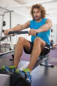 Man using resistance band in gym — Stock Photo