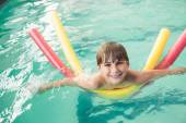 Little boy swimming in the pool — Stock Photo