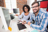 Photo editors using digitizer in office — Stock Photo