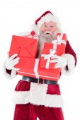 Santa carries a few presents — Stock Photo