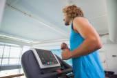 Man running on treadmill in gym — Foto Stock