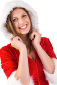 Smiling brunette in santa outfit — Stock Photo