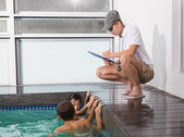 Cute kids in the swimming pool listening to coach — Stock Photo