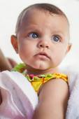 Cute baby wrapped in towel — Stockfoto