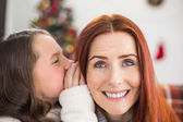 Daughter telling her mother a christmas secret — Stock Photo