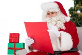Concentrated santa writing a list  — Stock Photo