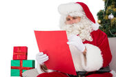 Concentrated santa writing a list  — Foto Stock