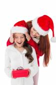 Festive mother surprising daughter with gift — Stock Photo