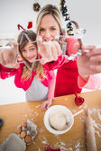 Festive mother and daughter making christmas cookies — Zdjęcie stockowe