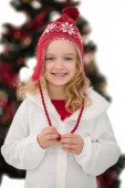 Festive little girl in hat and scarf — Stock Photo