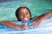 Cute little girl swimming in the pool — Foto Stock