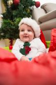 Cute baby boy in large christmas present — Stock Photo