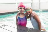 Cute little girls in the swimming pool — Foto de Stock