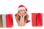 Thoughtful woman lying between shopping bags — Stockfoto