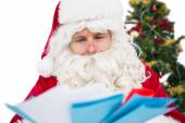 Father christmas showing many letters — Stock Photo