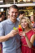 Happy couple drinking cocktails together — Stock Photo