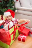 Cute boy in large christmas present — Stock Photo