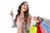 Beauty brunette holding credit card and shopping bags — Stock Photo