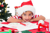 Festive little boy drawing pictures — Stock Photo