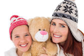 Mother and daughter holding teddy bear — Stock Photo