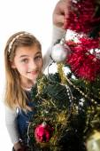 Festive little girl decorating christmas tree — Photo