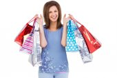 Portrait of cute young woman with shopping bags  — Stock Photo