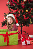Festive little girl sitting in large gift — Stock Photo