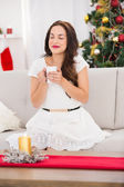 Peaceful brunette enjoying hot drink — Stock Photo