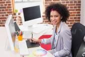 Smiling female photo editor using digitizer — Stock Photo