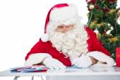 Father christmas writing letters  — Stock Photo