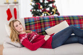 Day dreaming young woman lying on couch — Stock Photo
