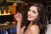Pretty brunette drinking a shot — Stock Photo