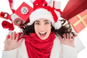 Excited brunette lying near christmas presents  — Stock Photo
