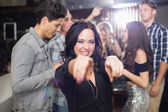 Stylish brunette smiling and dancing — Stock Photo
